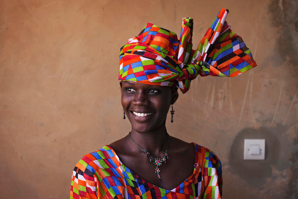 . Aminata Diop poses for a picture in her house in the village of Ndande, May 19, 2013. Every year, inhabitants of the village take part in a Sufi Muslim ceremony called Gamou-Ndande. The ceremony combines nights of praying and chanting as well as traditionally animist ceremonies. Picture taken May 19, 2013.  REUTERS/Joe Penney