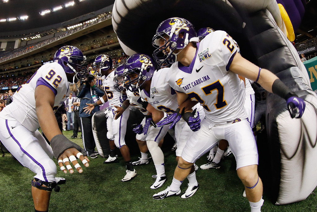 . The East Carolina Pirates take the field during the R+L Carriers New Orleans Bow at the Mercedes-Benz Superdome on December 22, 2012 in New Orleans, Louisiana.  (Photo by Chris Graythen/Getty Images)