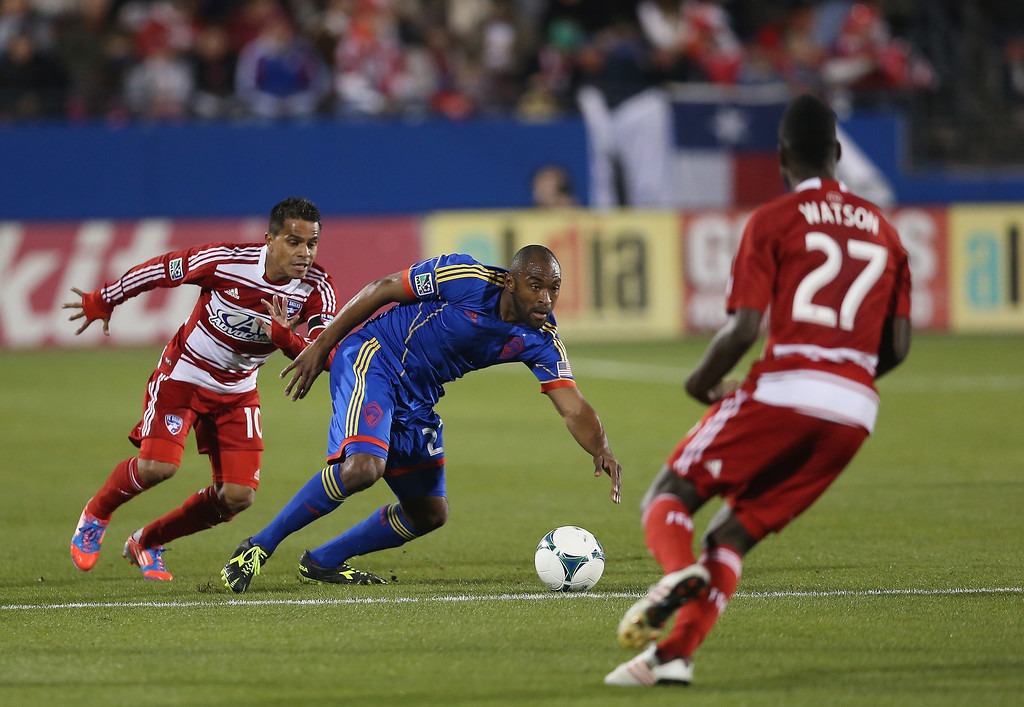 . FRISCO, TX - MARCH 02:  Marvell Wynne #22 of Colorado Rapids dribbles the ball against David Ferreira #10 of FC Dallas at FC Dallas Stadium on March 2, 2013 in Frisco, Texas.  (Photo by Ronald Martinez/Getty Images)