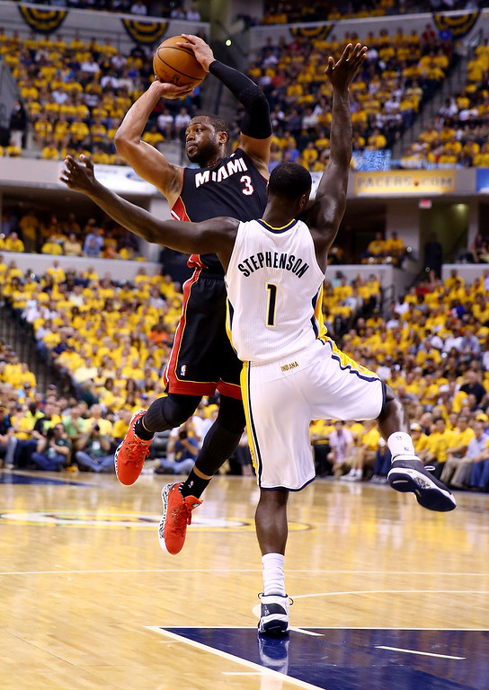 . INDIANAPOLIS, IN - MAY 28: Dwyane Wade #3 of the Miami Heat looks to pass as Lance Stephenson #1 of the Indiana Pacers defends during Game Five of the Eastern Conference Finals of the 2014 NBA Playoffs at Bankers Life Fieldhouse on May 28, 2014 in Indianapolis, Indiana.  (Photo by Andy Lyons/Getty Images)