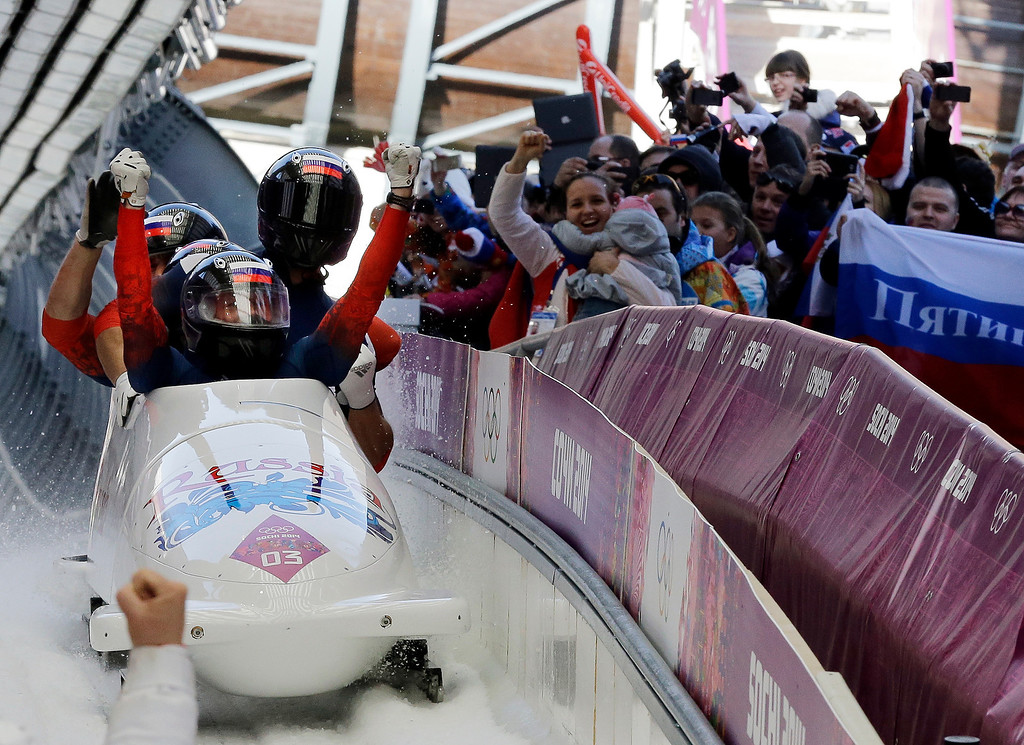. The team from Russia RUS-1, with Alexander Zubkov, Alexey Negodaylo, Dmitry Trunenkov, and Alexey Voevoda, celebrate after they won the gold medal during the men\'s four-man bobsled competition final at the 2014 Winter Olympics, Sunday, Feb. 23, 2014, in Krasnaya Polyana, Russia. (AP Photo/Dita Alangkara)