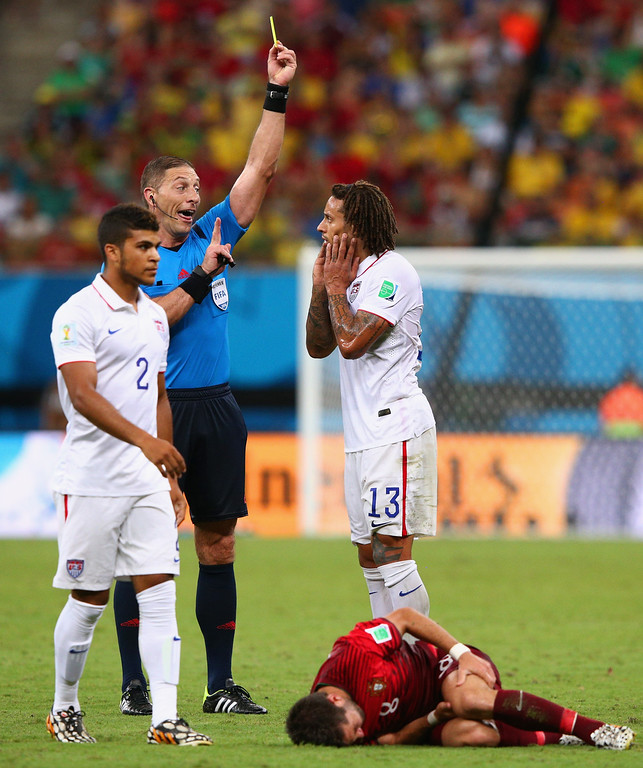 . Referee Nestor Pitana shows Jermaine Jones of the United States a yellow card during the 2014 FIFA World Cup Brazil Group G match between the United States and Portugal at Arena Amazonia on June 22, 2014 in Manaus, Brazil.  (Photo by Adam Pretty/Getty Images)