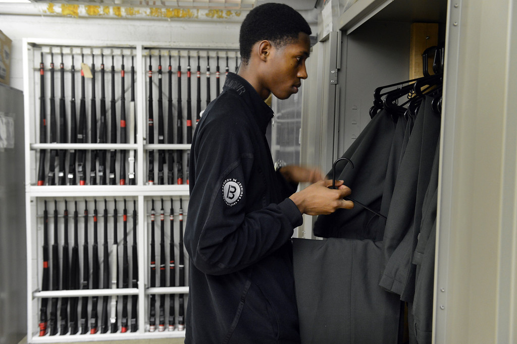 . DENVER, CO. - FEBRUARY 12: Senior Jaycee Floyd takes inventory of uniforms in his Junior Reserve Officer Training Corps office at East High School in Denver, CO February  07, 2013. Floyd is a Cadet Captain with the JROTC and a member of Project Greer Street an academic program that promotes achievement among male African-American high school students. (Photo By Craig F. Walker/The Denver Post)