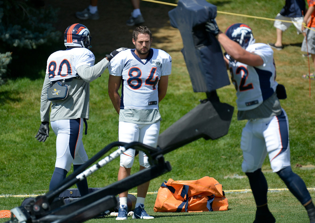 . Denver Broncos TE Julius Thomas (8) pats Jacob Tamme (84) on the shoulder as he watches Jake O\'Connel (82) in drills during training camp August 5, 2013 at Dove Valley. (Photo By John Leyba/The Denver Post)