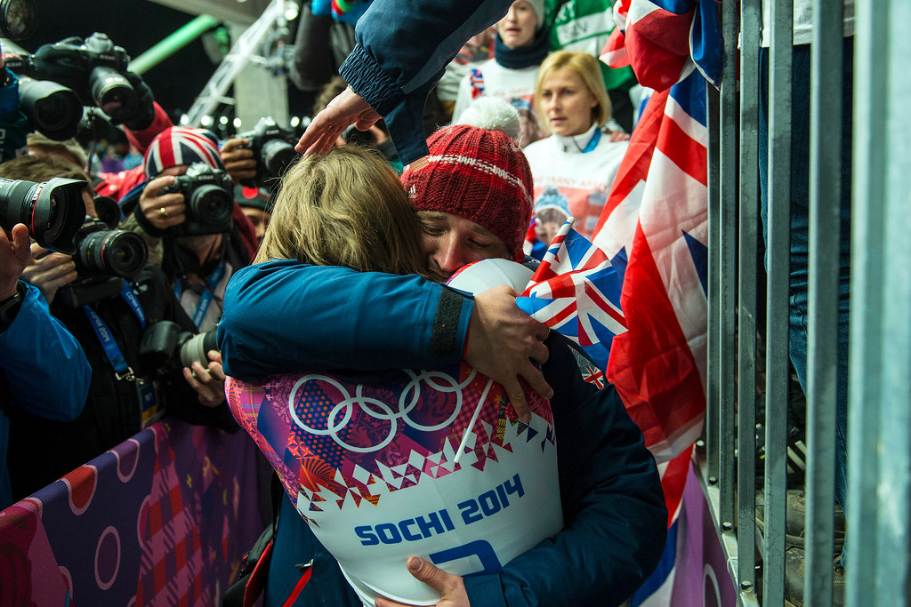 . KRASNAYA POLYANA, RUSSIA  - JANUARY 14: Gold medalist Elizabeth Yarnold hugs her boyfriend James Roche after winning the women\'s skeleton competition at Sanki Sliding Center during the 2014 Sochi Olympics Friday February 14, 2014.  (Photo by Chris Detrick/The Salt Lake Tribune)