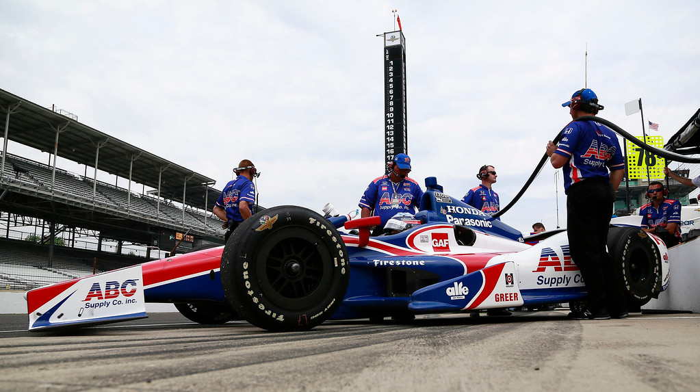 . A.J. Foyt Enterprises driver Takuma Sato of Japan sits in his car while his crew puts fuel in the tank during a practice session at the Indianapolis Motor Speedway in Indianapolis, Indiana May 16, 2013. The 97th running of the Indianapolis 500 is scheduled for May 26.  REUTERS/Brent Smith