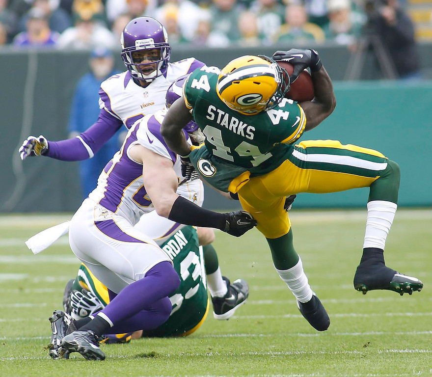 . Green Bay Packers running back James Starks (R) is tackled by Minnesota Vikings safety Harrison Smith during the first half of a NFL football game in Green Bay, Wisconsin December 2, 2012. REUTERS/Darren Hauck