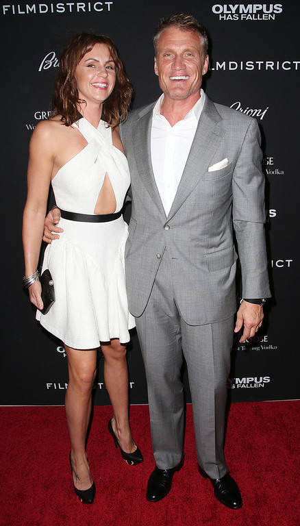 """. Actor Dolph Lundgren (R) and his guest attend the Premiere of FilmDistrict\'s \""""Olympus Has Fallen\"""" at the ArcLight Cinemas Cinerama Dome on March 18, 2013 in Hollywood, California.  (Photo by Frederick M. Brown/Getty Images)"""