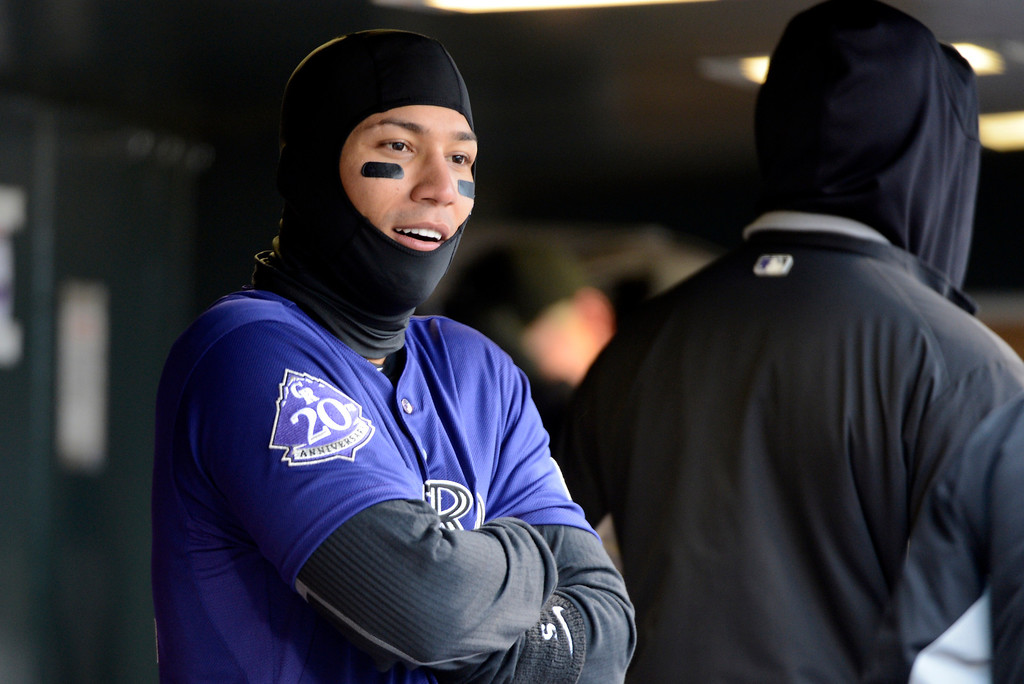 . DENVER, CO. - APRIL 16: Carlos Gonzalez of the Colorado Rockies keeps warm in the dugout during their game against the New York Mets April 16, 2013 at Coors Field. (Photo By John Leyba/The Denver Post)