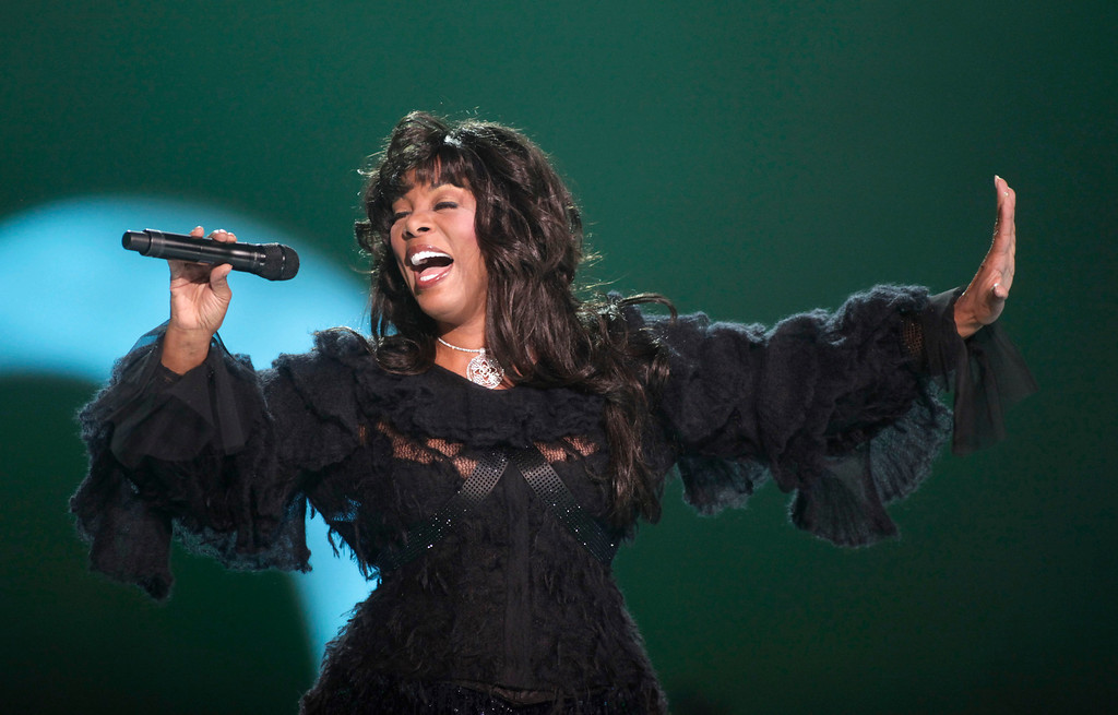 ". This Dec. 11, 2009 file photo shows Donna Summer performing at the Nobel Peace concert in Oslo, Norway. The eclectic group of rockers Rush and Heart, rappers Public Enemy, songwriter Randy Newman, ""Queen of Disco\"" Donna Summer and bluesman Albert King will be inducted into the Rock and Roll Hall of Fame next April in Los Angeles. The inductees were announced Tuesday by 2012 inductee Flea of The Red Hot Chili Peppers at a news conference in Los Angeles. (AP Photo/John McConnico, file)"