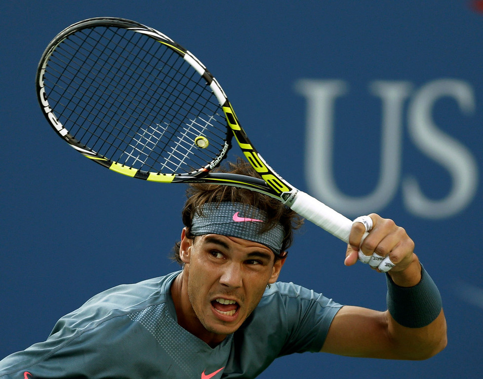 . Rafael Nadal, of Spain, follows through on a shot to Novak Djokovic, of Serbia, during the men\'s singles final of the 2013 U.S. Open tennis tournament, Monday, Sept. 9, 2013, in New York. (AP Photo/Darron Cummings)