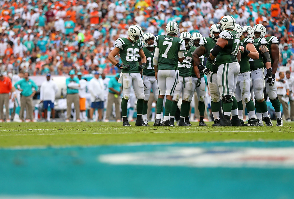 . Geno Smith #7 of the New York Jets calls a play during a game against the Miami Dolphins at Sun Life Stadium on December 29, 2013 in Miami Gardens, Florida.  (Photo by Mike Ehrmann/Getty Images)