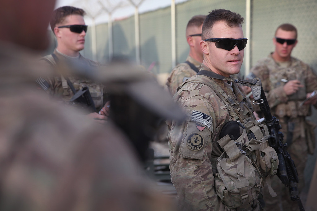. Soldiers from the U.S. Army\'s 4th squadron 2d Cavalry Regiment get a mission brief prior to a patrol on February 25, 2014 near Kandahar, Afghanistan.  (Photo by Scott Olson/Getty Images)
