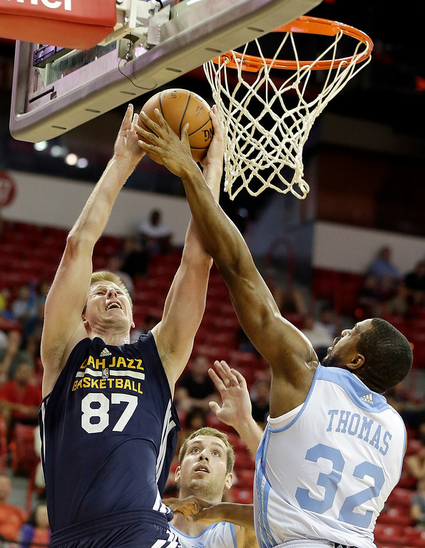 . Utah Jazz\'s Brock Motum (87) shoots covered by Denver Nuggets\' Will Thomas (32) during the first half of an NBA summer league basketball game Tuesday, July 15, 2014, in Las Vegas. (AP Photo/Isaac Brekken)