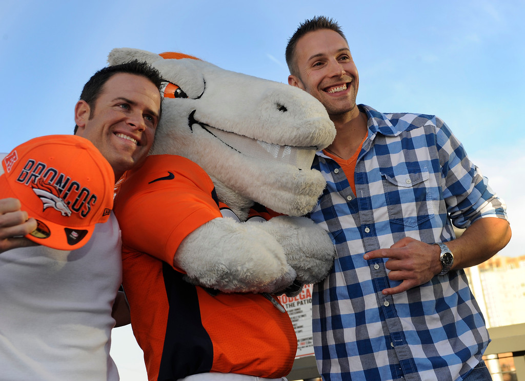 . Scott Roahrig, left, and Tyler Capron, right, posed for a photo with Denver Broncos mascot Miles Thursday night. Broncos fans gathered for a NFL draft party at the Tavern Downtown, 1949 Market Street, Thursday night, April 25, 2013. Photo By Karl Gehring/The Denver Post