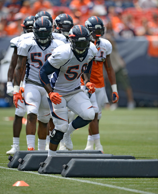 . Denver Broncos outside linebacker Von Miller (58) runs through drills on day four of the Denver Broncos 2014 training camp July 27, 2014 at Sports Authority Field at Mile High. (Photo by John Leyba/The Denver Post)