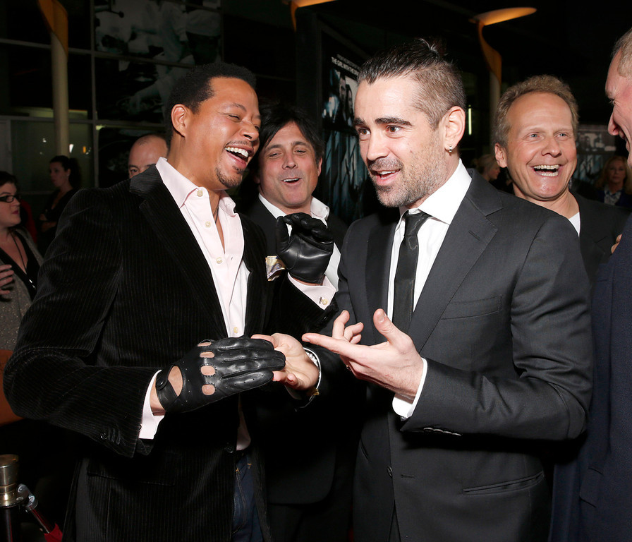 ". Colin Farrell admires Terrence Howard\'s gloves at the world premiere of ""Dead Man Down\"" at the Archlight Hollywood on Tuesday , Feb. 26, 2013 in Los Angeles. (Photo by Todd Williamson/Invision/AP)"