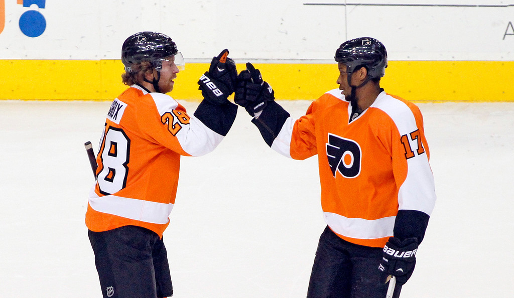 . Philadelphia Flyers\' Claude Giroux, left, and Wayne Simmonds celebrate Giroux\' open-net goal at the end of an NHL hockey game against the Colorado Avalanche, Thursday, Feb. 6, 2014, in Philadelphia. The Flyers won 3-1. (AP Photo/Tom Mihalek)