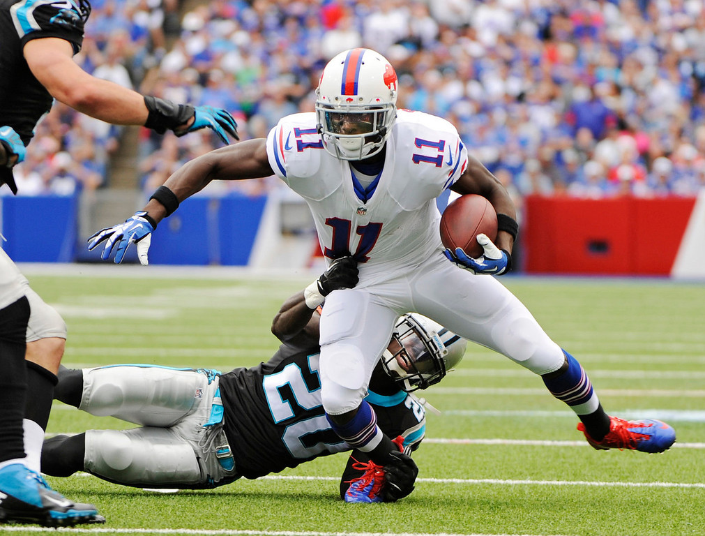 . Buffalo Bills wide receiver T.J. Graham (11) is tackled by Carolina Panthers cornerback D.J. Moore in the third quarter of an NFL football game Sunday, Sept. 15, 2013, in Orchard Park, N.Y. (AP Photo/Gary Wiepert)