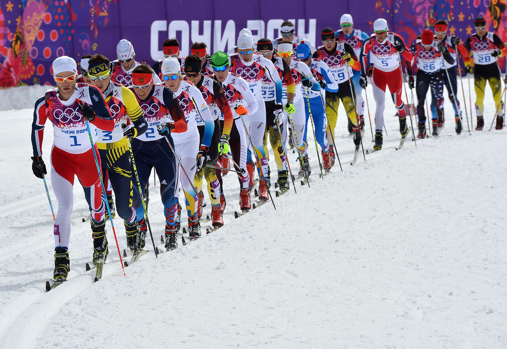 . Norway\'s Martin Johnsrud Sundby (L) leads the pack in the Men\'s Cross-Country Skiing 15km + 15km Skiathlon at the Laura Cross-Country Ski and Biathlon Center during the Sochi Winter Olympics on February 9, 2014, in Rosa Khutor. ALBERTO PIZZOLI/AFP/Getty Images