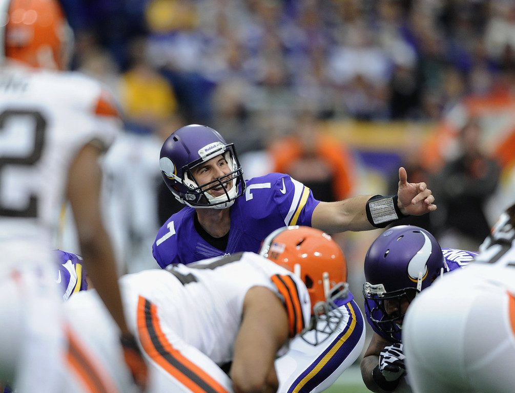 . Christian Ponder #7 of the Minnesota Vikings calls a play at the line of scrimmage during the first quarter of the game against the Cleveland Browns on September 22, 2013 at Mall of America Field at the Hubert H. Humphrey Metrodome in Minneapolis, Minnesota. (Photo by Hannah Foslien/Getty Images)
