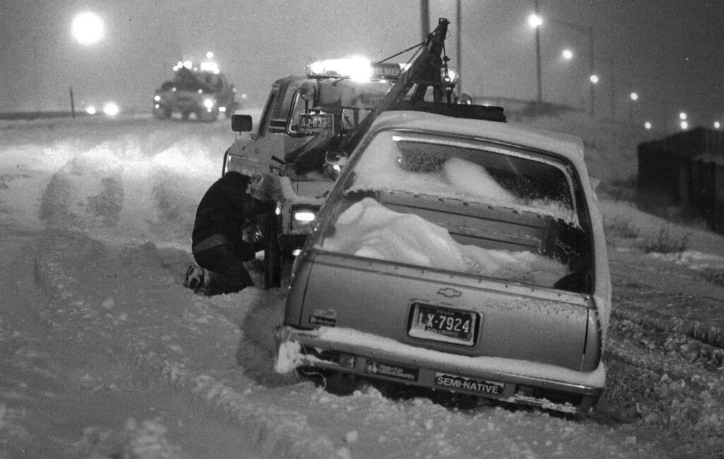 . Tow trucks haul away abandoned vehicles in the Blizzard of \'82. Denver Post Library Archive