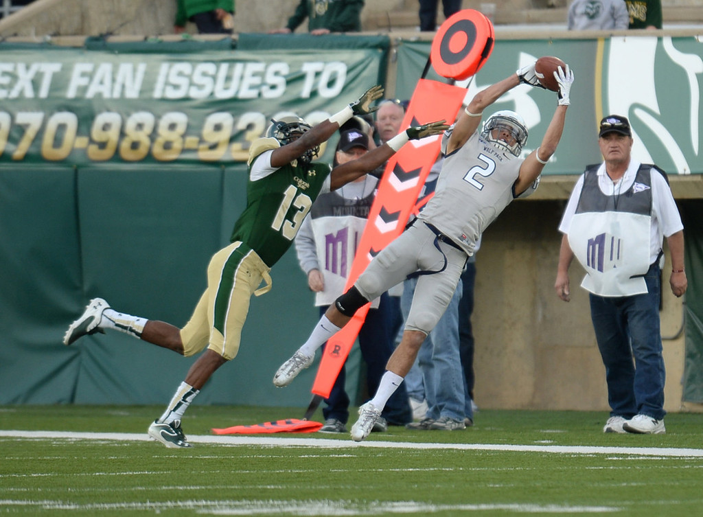 . Fort Collins, CO. NOVEMBER 09 :Richy Turner of University of Nevada (2) incomplete the catch by DeAndre Elliott of Colorado State University (13) in the 4th quarter of the game at Hughes Stadium. Fort Collins. Colorado. November 09, 2013. CSU won 38-17. (Photo by Hyoung Chang/The Denver Post)