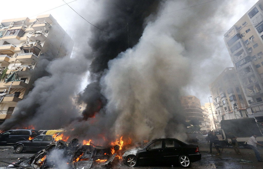 . Smoke rises from burning cars at site of an explosion in Beirut\'s southern suburb neighborhood of Bir al-Abed on July 9, 2013.  AFP PHOTO/STR-/AFP/Getty Images