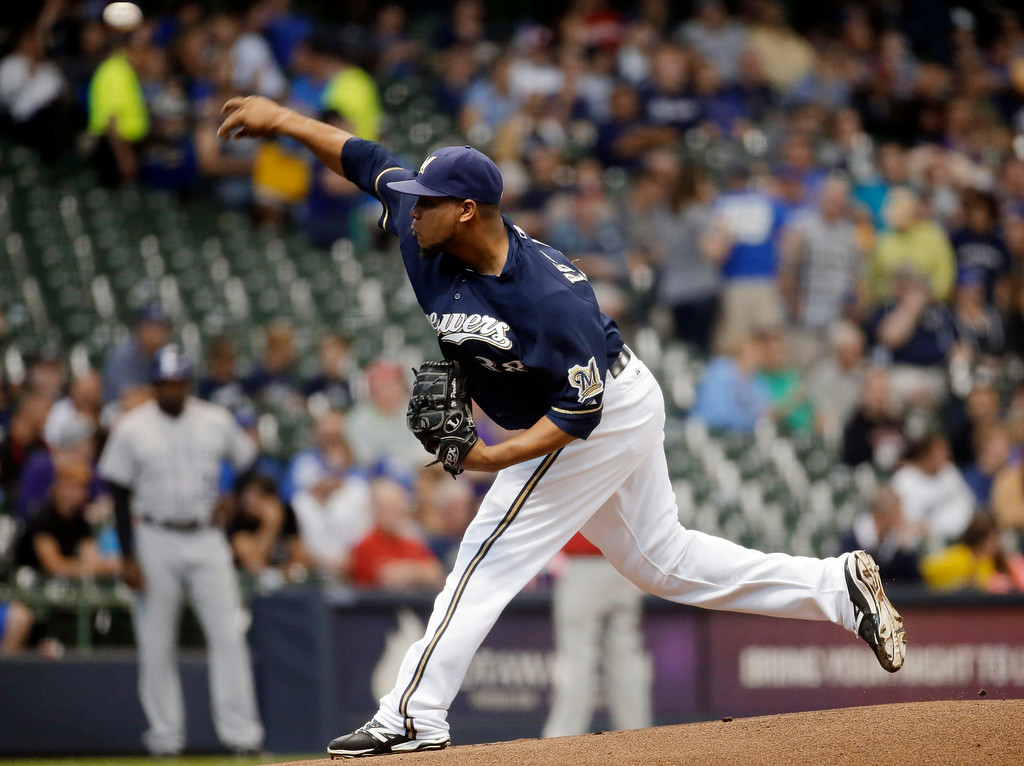 . Milwaukee Brewers starting pitcher Wily Peralta throws during the first inning of a baseball game against the Colorado Rockies on Thursday, June 26, 2014, in Milwaukee. (AP Photo/Morry Gash)