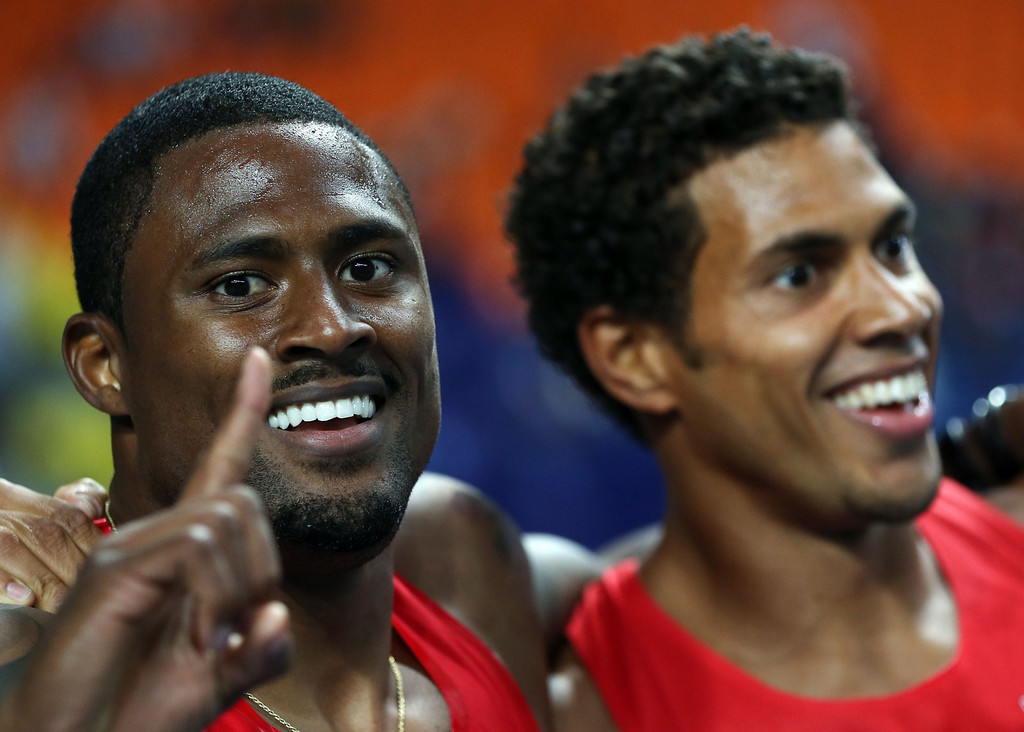 . US\'s David Oliver (L) celebrates with his compatriot Ryan Wilson after respectively winning the gold and silver medals in the men\'s 110 meters hurdles at the 2013 IAAF World Championships at the Luzhniki stadium in Moscow on August 12, 2013. AFP PHOTO / ADRIAN DENNIS/AFP/Getty Images