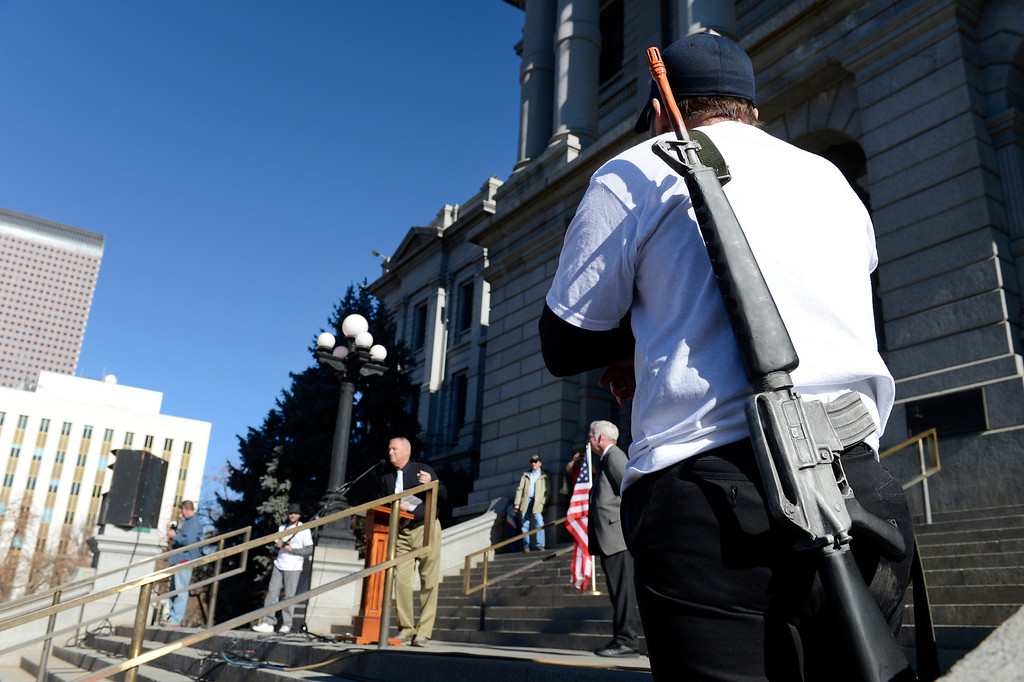 . DENVER, CO. - JANUARY  19: A gun rights supporter (who chose not to give his name) strapped a toy replica of a machine gun to his bak during a pro gun rally at the Colorado State Capitol Saturday afternoon, January 19th, 2013.  (Photo By Andy Cross / The Denver Post)