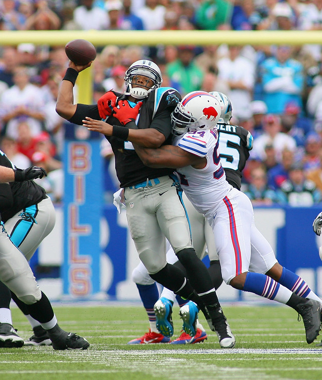 . Cam Newton #1 of the Carolina Panthers is sacked by  Mario Williams #94 of the Buffalo Bills at Ralph Wilson Stadium on September 15, 2013 in Orchard Park, New York.  (Photo by Rick Stewart/Getty Images)