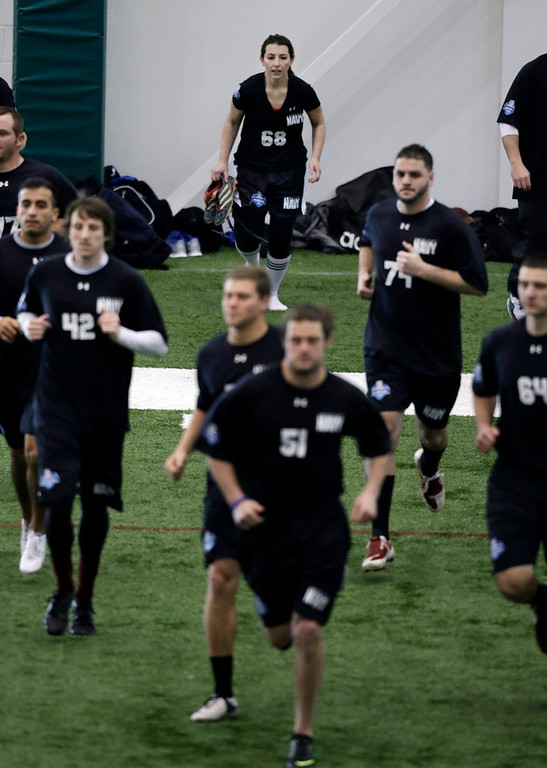 . Lauren Silberman, center back, runs onto the indoor turf before kicker tryouts at the NFL football regional combine workout on Sunday, March 3, 2013, in Florham Park, N.J. (AP Photo/Mel Evans)