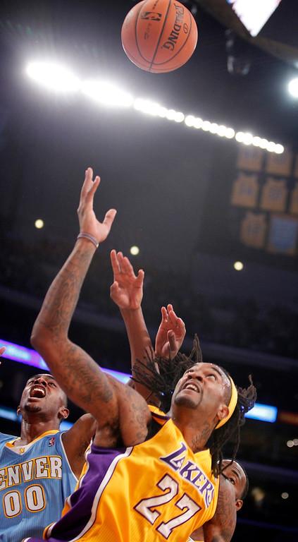 . Denver Nuggets forward Darrell Arthur, left, battles for the ball against Los Angeles Lakers center Jordan Hill in the first quarter during an NBA preseason basketball game Sunday, Oct. 6, 2013 in Los Angeles. (AP Photo/Alex Gallardo)