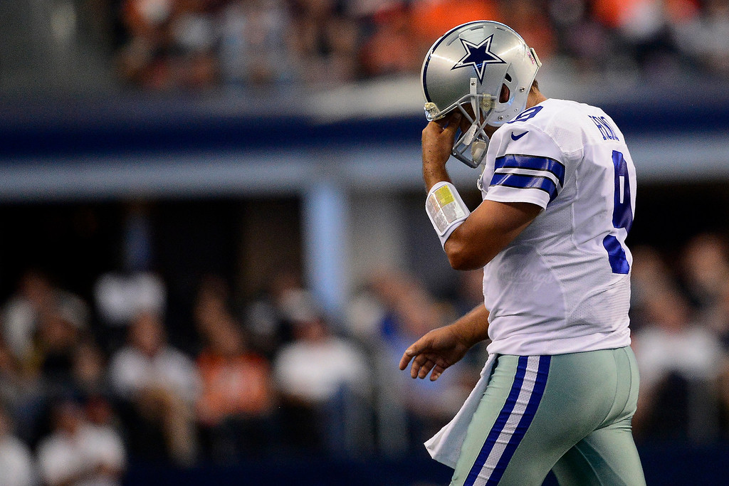 . Tony Romo (9) of the Dallas Cowboys rubs his face after failing to convert a third down against the Denver Broncos during the first half of action at AT&T Stadium.   (Photo by AAron Ontiveroz/The Denver Post)