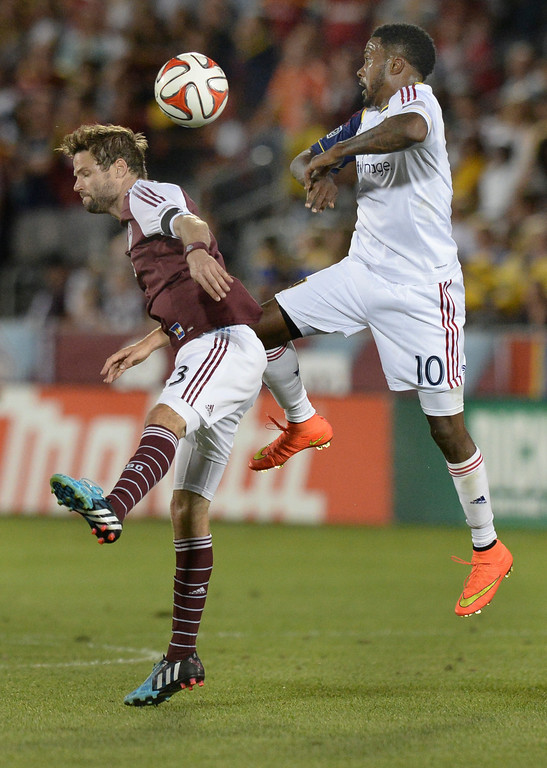 . COMMERCE CITY, CO - AUGUST 2: Colorado defender Drew Moor (3) challenged Salt Lake forward Robbie Findley (10) for a ball in the second half.  Real Salt Lake defeated the Colorado Rapids 1-0 at Dick\'s Sporting Goods Park Saturday night, August 2, 2014.  Photo by Karl Gehring/The Denver Post