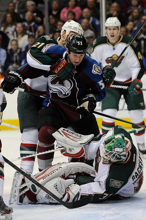 . Kyle Brodziak (21) of the Minnesota Wild holds Cody McLeod (55) of the Colorado Avalanche back while crowding Minnesota Wild goalie (32) Niklas Backstrom during the third period, Saturday, April 27, 2012 at Pepsi Center. Seth A. McConnell, The Denver Post