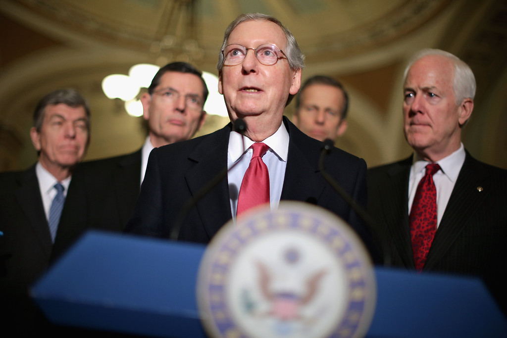 . WASHINGTON, DC - JANUARY 28:  Senate Minority Leader Mitch McConnell (R-KY) (C) talks to reporters after the weekly Republican Senate caucus luncheon with (L-R) Sen. Roy Blunt (R-MO), Sen. John Barrasso (R-WY), Sen. John Thune (R-SD) and Sen. John Cornyn (R-TX) at the U.S. Capitol January 28, 2014 in Washington, DC. Senate Republicans took swings at President Barack Obama and his policies hours before he is scheduled to deliver his sixth State of the Union speech before a joint session of Congress.  (Photo by Chip Somodevilla/Getty Images)