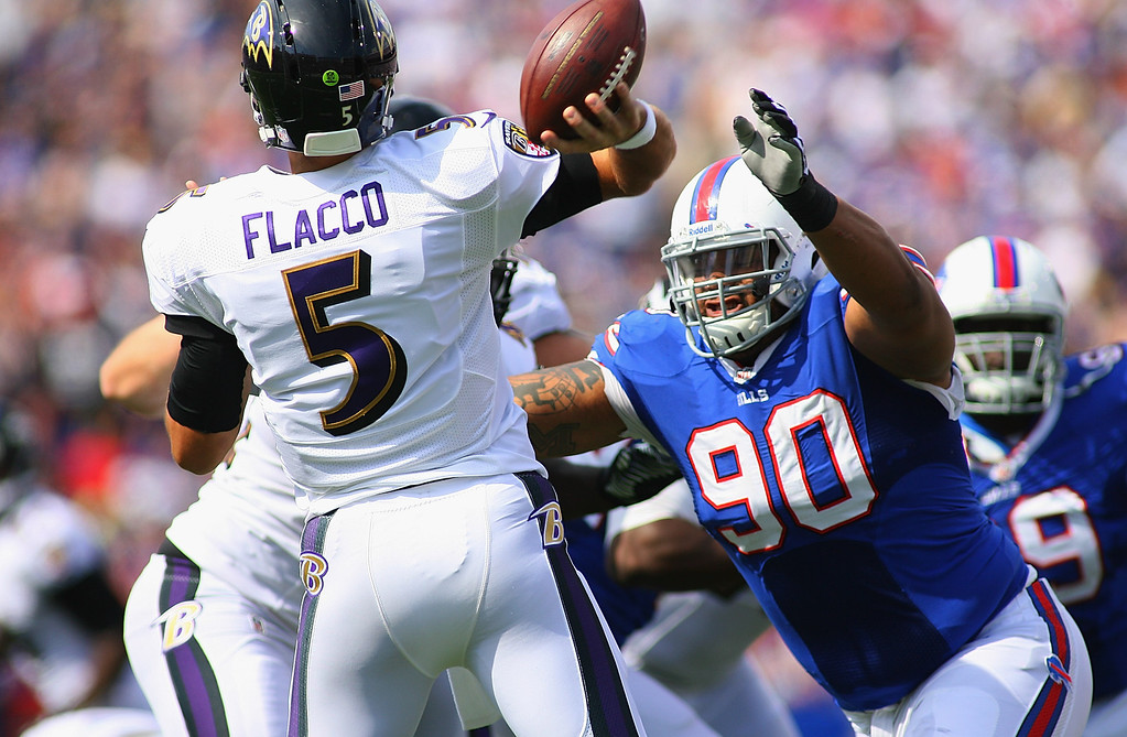 . ORCHARD PARK, NY - SEPTEMBER 29:  Alan Branch #90 of the Buffalo Bills pressures  Joe Flacco #5 of the Baltimore Ravens at Ralph Wilson Stadium on September 29, 2013 in Orchard Park, New York.  (Photo by Rick Stewart/Getty Images)