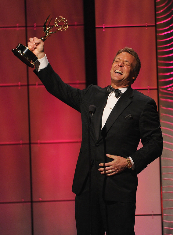 ". Actor Doug Davidson accepts the Outstanding Lead Actor in a Drama Series award for ""The Young and the Restless\"" onstage during The 40th Annual Daytime Emmy Awards at The Beverly Hilton Hotel on June 16, 2013 in Beverly Hills, California.  (Photo by Kevin Winter/Getty Images)"