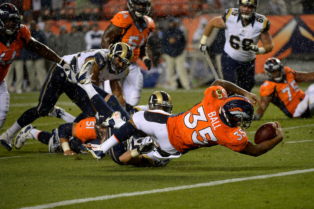 . DENVER, CO. - August 24: running back Lance Ball (35) of the Denver Broncos scores in the 4th quarter vs the St. Louis Rams during the 3rd pre-season game of the season at Sports Authority Field at Mile High. August 24, 2013 Denver, Colorado. (Photo By Joe Amon/The Denver Post)