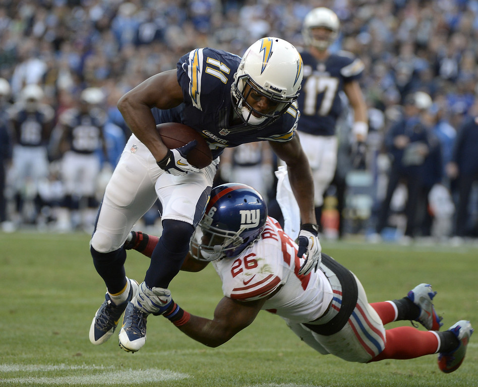 . SAN DIEGO, CA - DECEMBER 8:  Eddie Royal #11 of the San Diego Chargers catches the ball against the New York Giants during their game on December 8, 2013 at Qualcomm Stadium in San Diego, California. (Photo by Donald Miralle/Getty Images)