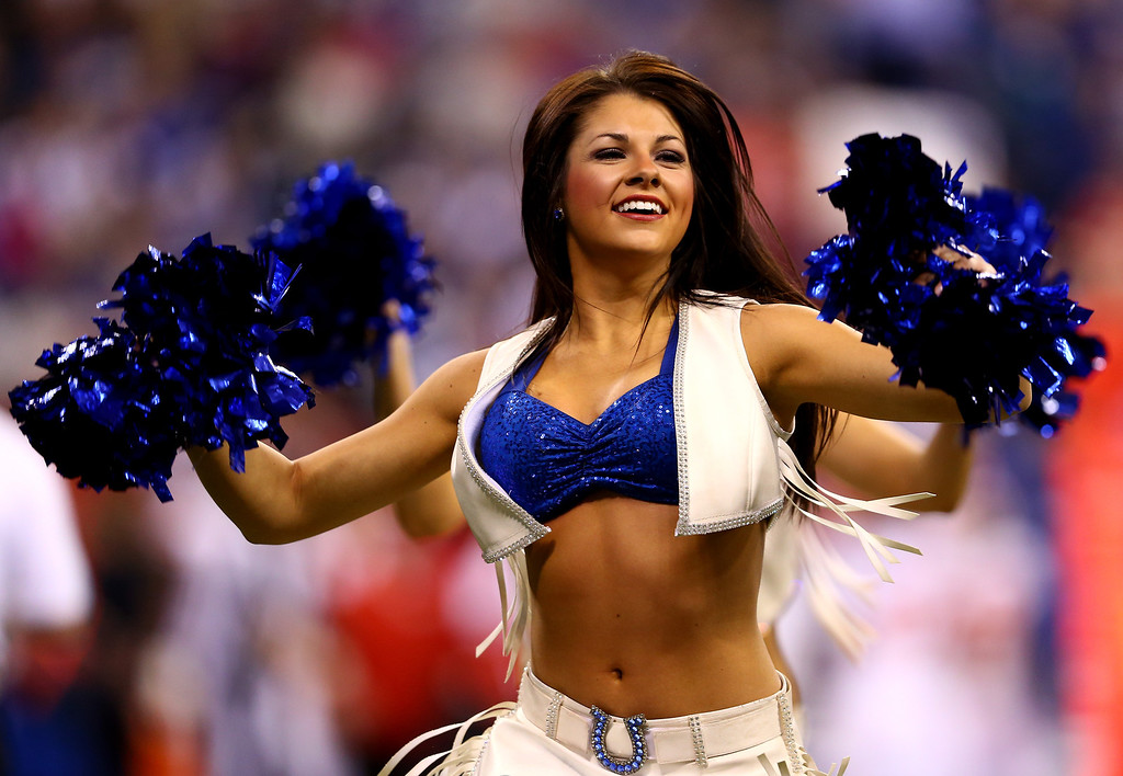 . INDIANAPOLIS, IN - JANUARY 04:  An Indianapolis Colts cheerleader performs during a Wild Card Playoff game against the Kansas City Chiefs at Lucas Oil Stadium on January 4, 2014 in Indianapolis, Indiana.  (Photo by Andy Lyons/Getty Images)
