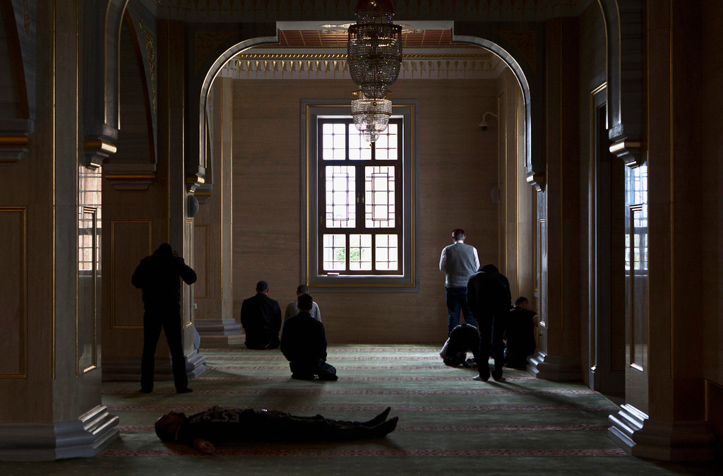 . Muslim men wait for Friday prayers in the Heart of Chechnya Mosque in the Chechen capital Grozny April 26, 2013. The naming of two Chechens, Dzhokhar and Tamerlan Tsarnaev, as suspects in the Boston Marathon bombings has put Chechnya - the former site of a bloody separatist insurgency - back on the world\'s front pages. Chechnya appears almost miraculously reborn. The streets have been rebuilt. Walls riddled with bullet holes are long gone. New high rise buildings soar into the sky. Spotless playgrounds are packed with children. A giant marble mosque glimmers in the night. Yet, scratch the surface and the miracle is less impressive than it seems. Behind closed doors, people speak of a warped and oppressive place, run by a Kremlin-imposed leader through fear.  Picture taken April 26, 2013.   REUTERS/Maxim Shemetov