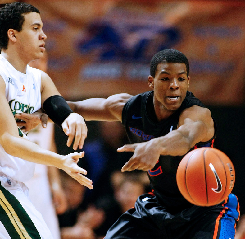 . Boise State guard Derrick Marks (2) steals a pass from Colorado State guard Dorian Green (22) during an NCAA college basketball game in Boise, Idaho, Saturday, March 2, 2013.  (AP Photo/Darin Oswald)