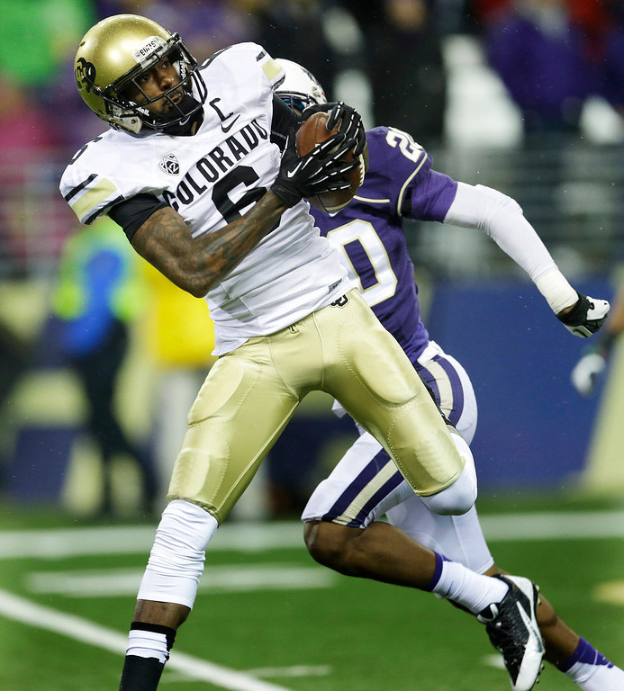 . Colorado wide receiver Paul Richardson (6) pulls down a touchdown catch in front of Washington defensive back Kevin King in the first half of an NCAA college football game on Saturday, Nov. 9, 2013, in Seattle. (AP Photo/Ted S. Warren)
