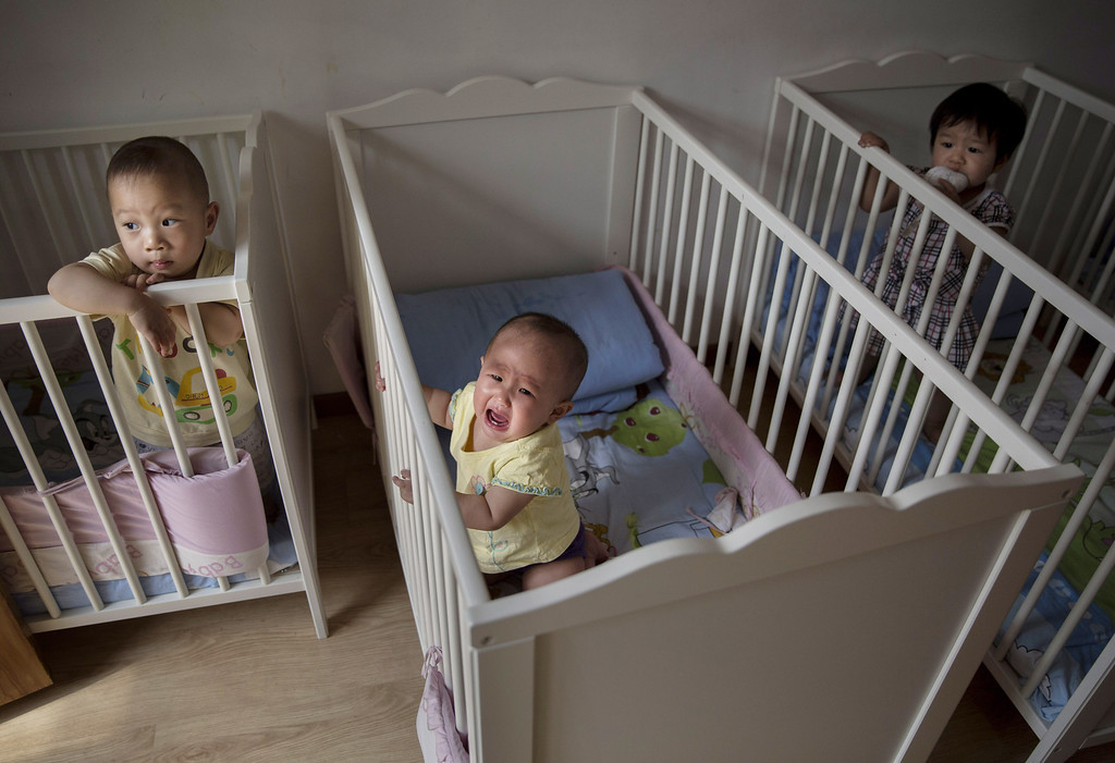 . Young orphaned Chinese children are seen in cribs at a foster care center on April 2, 2014 in Beijing, China. (Photo by Kevin Frayer/Getty Images)