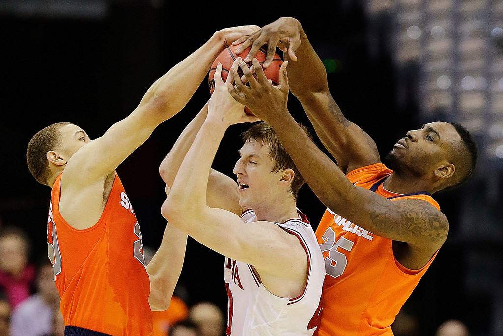 . Indiana forward Cody Zeller (40) is trapped between Syracuse guard Brandon Trich, left, and forward Rakeem Christmas (25) during the first half of an East Regional semifinal in the NCAA college basketball tournament, Thursday, March 28, 2013, in Washington. (AP Photo/Alex Brandon)