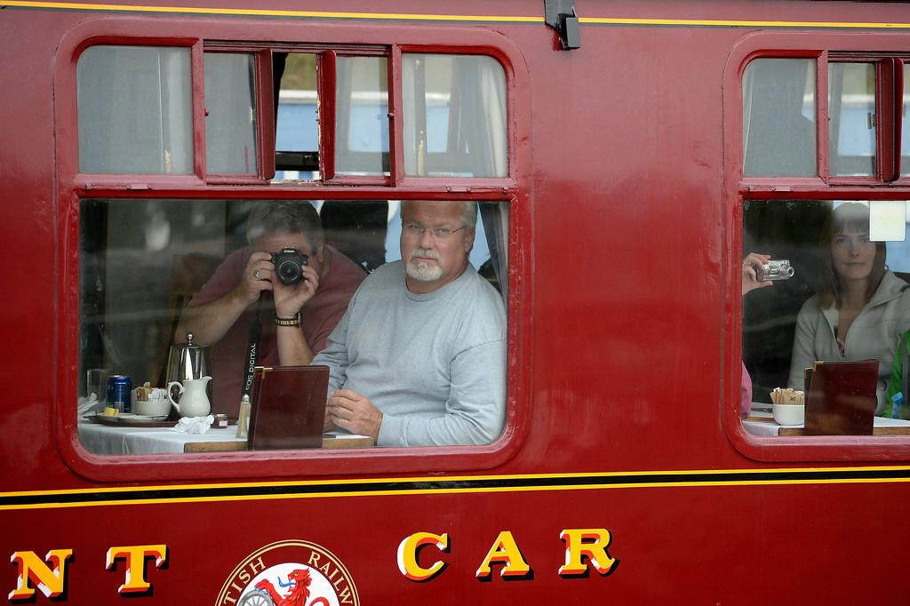 . Passengers travel on a 1952 British Rail Ivatt number 46512 at Strathspey Steam Railway on August 27, 2013 in Aviemore, Scotland.  (Photo by Jeff J Mitchell/Getty Images)