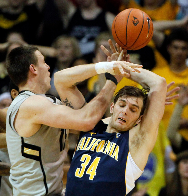 . California forward Robert Thurman, right, is fouled by Colorado forward Shane Harris-Tunks as they fight for control of a rebound in the first half of an NCAA basketball game in Boulder, Colo., Sunday, Jan. 27, 2013. (AP Photo/David Zalubowski)